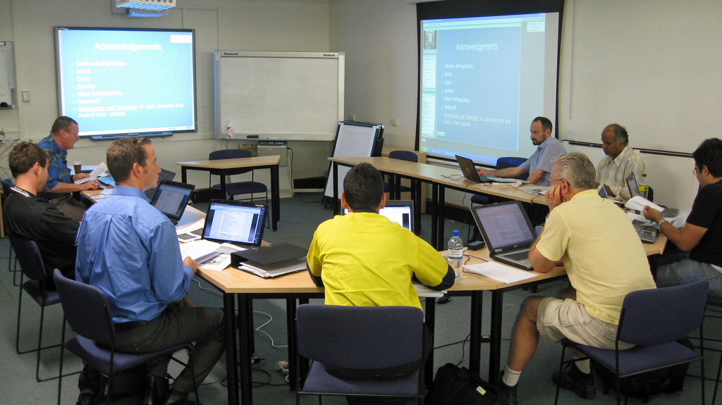 Image from the f2f side of an Adobe Connect Pro webinar at Ultimo Campus for the Diploma of HVAC  & R Engineering at Ultimo Campus. Up to 20 students connect to the webinar online from all across Australia with the trainer and students who are f2f. Most of the students bring their own notebook and connect to the wireless network and engage in the chat online and access the Course Moodle